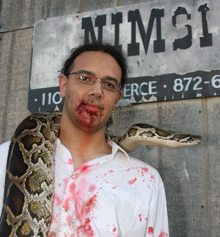John posing with a snake