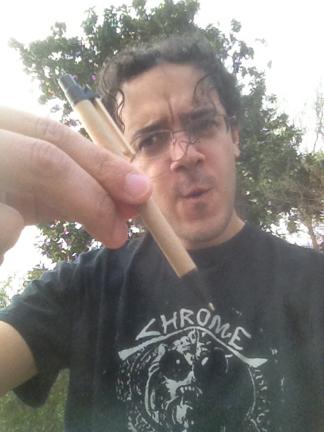 John holding a pen