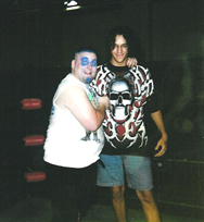 Professional wrestler The Blue Meanie with JEL in the late 1990s